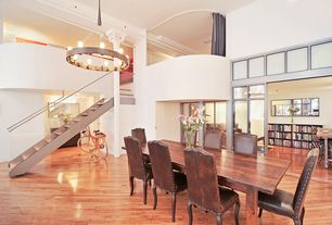 Contemporary Dining Room with Exposed beam, Cathedral ceiling, Hardwood floors, Loft, Chandelier, Columns