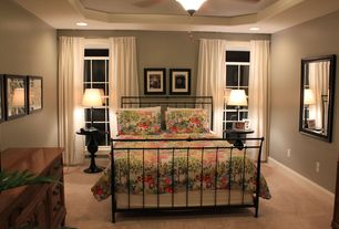 Traditional Master Bedroom with Ceiling fan, Carpet, Built-in bookshelf