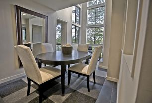 Modern Dining Room with Standard height, Carpet, Concrete tile