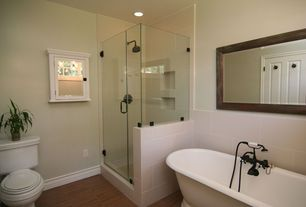 Traditional Master Bathroom with Concrete floors, Shower, Rain shower, Standard height, frameless showerdoor, Bathtub