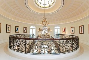 Traditional Staircase with Double staircase, sandstone floors, Wall sconce, Cathedral ceiling