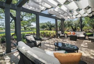 Tropical Patio with Trellis, North cape wicker montclair chair, North cape wicker montclair sofa, exterior stone floors