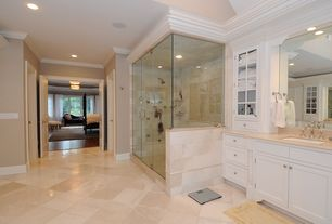 Traditional Master Bathroom with Crown molding, specialty door, Daltile Baja Cream Brick-Joint Polished Travertine, Limestone