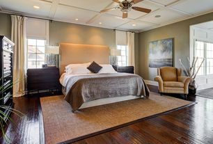 Contemporary Master Bedroom with Box ceiling, Skyline Furniture Linen Upholstered Headboard, Hardwood floors, Ceiling fan