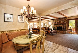 Traditional Great Room with stone fireplace, interior wallpaper, Exposed beam, Chandelier, can lights, Fireplace, Columns