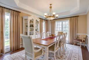 Traditional Dining Room with Hardwood floors, Custom Dining Chair Design #6386, Chandelier, Chair rail, Crown molding