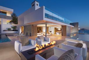 Modern Patio with exterior tile floors, Raised beds, Fire pit