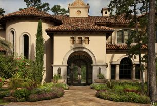 Mediterranean Exterior of Home with exterior brick floors, Raised beds, Arched window, French doors, picture window, Pathway