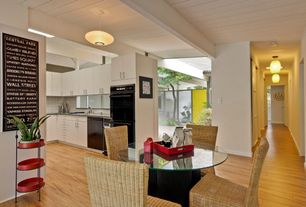 Contemporary Dining Room with Exposed beam, Standard height, Hardwood floors, Pendant light