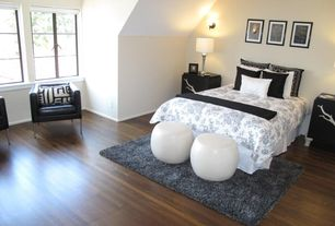 Contemporary Master Bedroom with Hardwood floors, Wall sconce