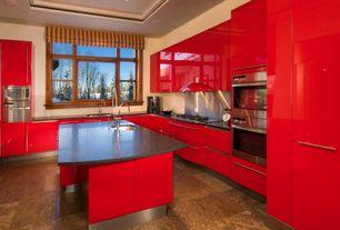 Contemporary Kitchen with slate tile floors, stone tile floors, Custom hood, Kitchen island, full backsplash, U-shaped, Flush