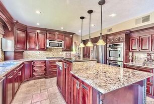 Traditional Kitchen with U-shaped, limestone tile floors, Flush, MS International - Blanco Tulum Granite Countertop