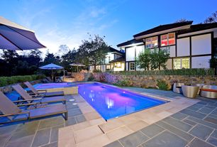 Contemporary Swimming Pool with exterior tile floors, Raised beds, French doors, Lap pool