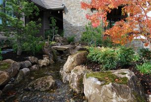 Asian Landscape/Yard with Garden pond, Pond, exterior stone floors, Exterior stone wall, Pathway
