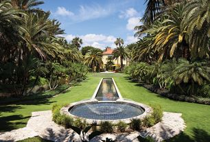 Mediterranean Landscape/Yard with Pathway, exterior stone floors, Fountain, Raised beds
