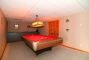 Craftsman Game Room with Box ceiling, Pendant light, Built-in bookshelf, Carpet
