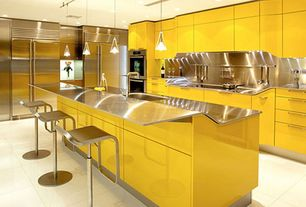 Contemporary Kitchen with Stainless Steel, limestone tile floors, can lights, European Cabinets, Kitchen island, Flush