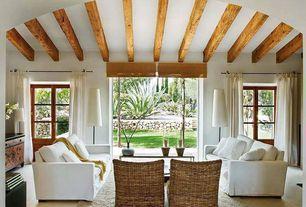 Tropical Living Room with Exposed beam, Laminate floors, Grandin Road Rockport Slipper Chair, Glass panel door