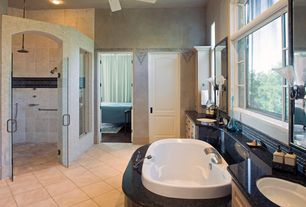 Contemporary Master Bathroom with Simple granite counters, Ceiling fan, Flat panel cabinets, specialty door, Flush