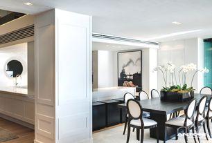 Contemporary Dining Room with Built-in bookshelf, Wainscotting, Hardwood floors