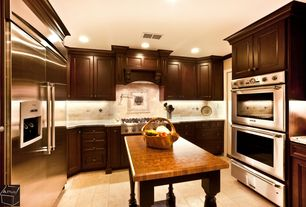 Traditional Kitchen with Flat panel cabinets, stone tile floors, Built In Refrigerator, Wall Hood, electric cooktop, U-shaped