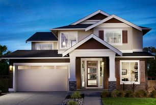 Traditional Exterior of Home with exterior tile floors, Fence, Glass panel door