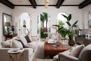 Tropical Living Room with French doors, Pendant light, Built-in bookshelf, Arched window, Exposed beam, Concrete floors