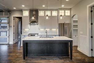 Contemporary Kitchen with Pendant light, Undermount sink, Subway Tile, Standard height, L-shaped, specialty door, Wall Hood