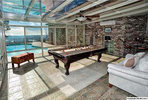 Contemporary Playroom with Exposed beam, slate tile floors, interior brick, Ceiling fan, Skylight
