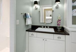 Modern Full Bathroom with Wall sconce, Soapstone, Concrete floors, Flat panel cabinets, Soapstone counters, Flush