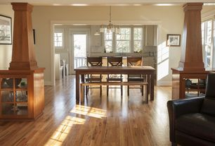 Craftsman Dining Room with Chandelier, double-hung window, High ceiling, Columns, Hardwood floors