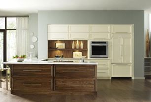 Contemporary Kitchen with Undermount sink, L-shaped, wall oven, can lights, Corian counters, Flush, electric cooktop, Paint