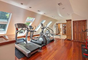 Traditional Home Gym with double-hung window, picture window, can lights, Hardwood floors, Standard height, French doors