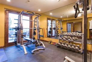 Traditional Home Gym with French doors, Concrete floors