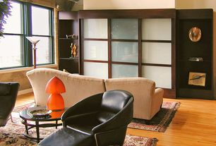 Modern Living Room with High ceiling, Built-in bookshelf, Hardwood floors