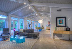 Modern Great Room with Pendant light, flush light, Ceiling fan, sandstone tile floors, French doors, Standard height