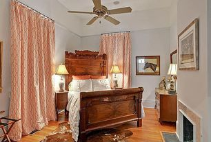 Eclectic Guest Bedroom with stone fireplace, Standard height, Fireplace, Hardwood floors, Ceiling fan, can lights