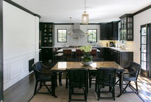 Traditional Dining Room with Wainscotting, French doors, Pendant light, Standard height, Hardwood floors, can lights