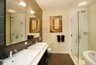 Modern Master Bathroom with wall-mounted above mirror bathroom light, stone tile floors, can lights, Shower, Corian counters