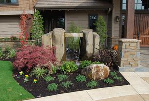 Craftsman Landscape/Yard with Raised beds, Barn door, Pond, Fountain, Transom window, Pathway, exterior stone floors