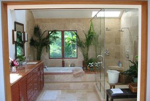 Tropical Master Bathroom with frameless showerdoor, Rain shower, Simple granite counters, Master bathroom, European Cabinets
