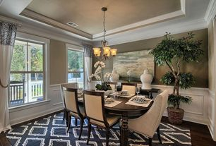 Traditional Dining Room with Hardwood floors, Wainscotting, Crown molding, Chandelier