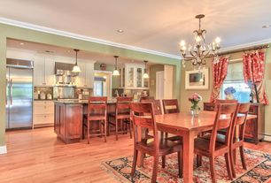 Craftsman Dining Room with Hardwood floors, Chandelier, Crown molding