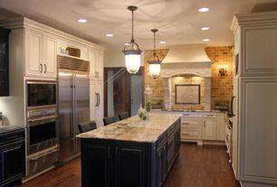 Traditional Kitchen with Custom hood, Limestone Tile, Farmhouse sink