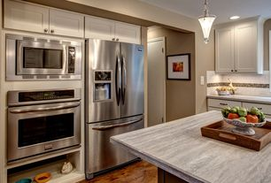 Craftsman Kitchen with Flat panel cabinets, Arizona tile silver travertine vein cut, Pendant light, L-shaped, Ceramic Tile
