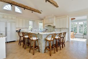 Country Kitchen with limestone tile floors, Ceramic Tile, Undermount sink, Breakfast bar, L-shaped, Complex marble counters