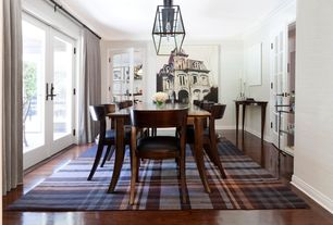 Contemporary Dining Room with French doors, Crown molding, Hardwood floors, Pendant light