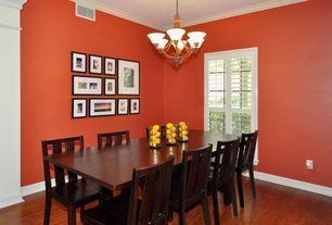 Traditional Dining Room with Crown molding, Hardwood floors, Chandelier