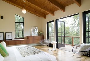 Contemporary Master Bedroom with Bertoia Diamond Lounge Chair, Pendant light, Exposed beam, Balcony, French doors
