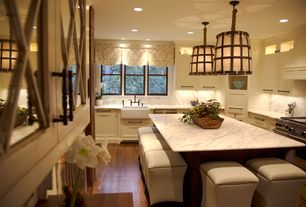 Traditional Kitchen with Complex marble counters, Inset cabinets, Crown molding, Complex Marble, Pendant light, Custom hood